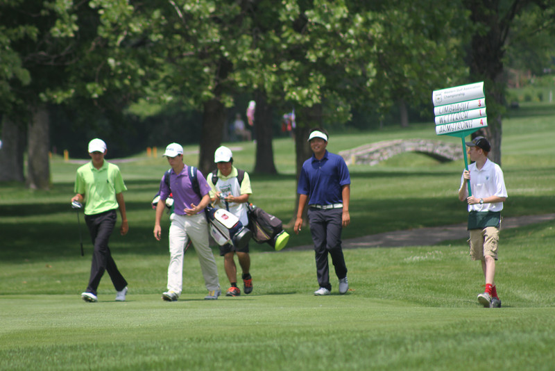 The lead group of KK Limbhasut, Michael Wetterich and Dawson Armstrong walks up the fairway during the third round of the 2014 Western Junior Championship.