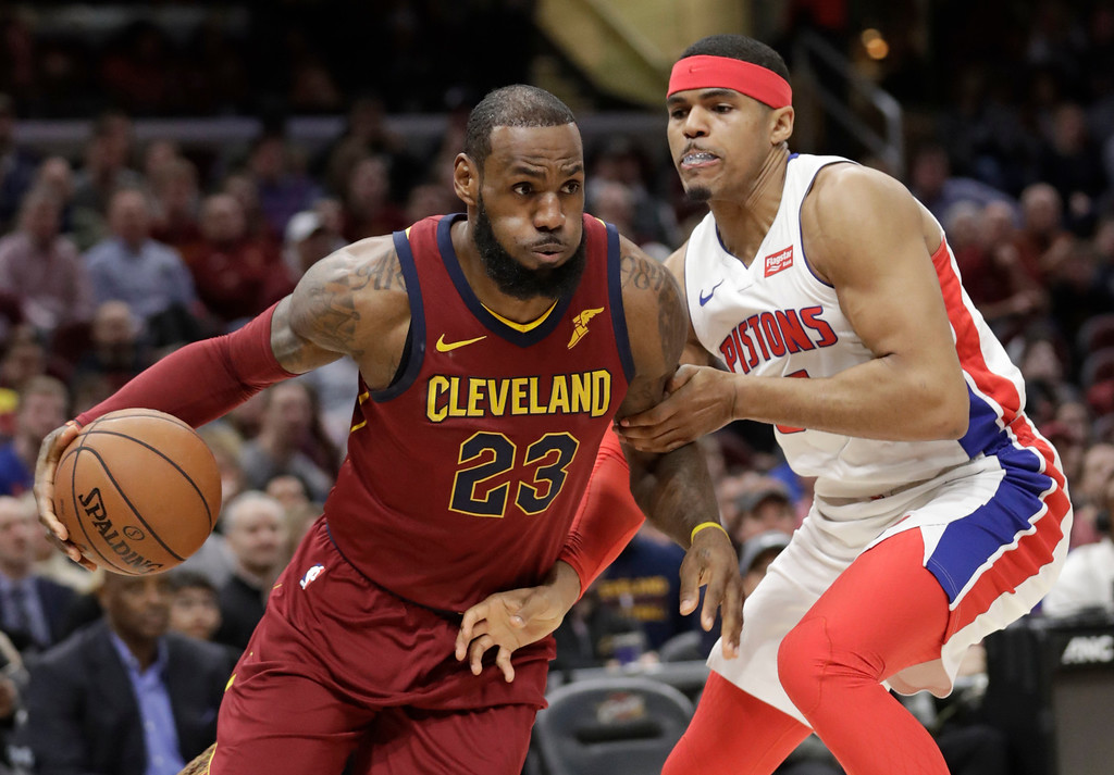 . Cleveland Cavaliers\' LeBron James (23) drives against Detroit Pistons\' Tobias Harris, right, in the first half of an NBA basketball game, Sunday, Jan. 28, 2018, in Cleveland. (AP Photo/Tony Dejak)