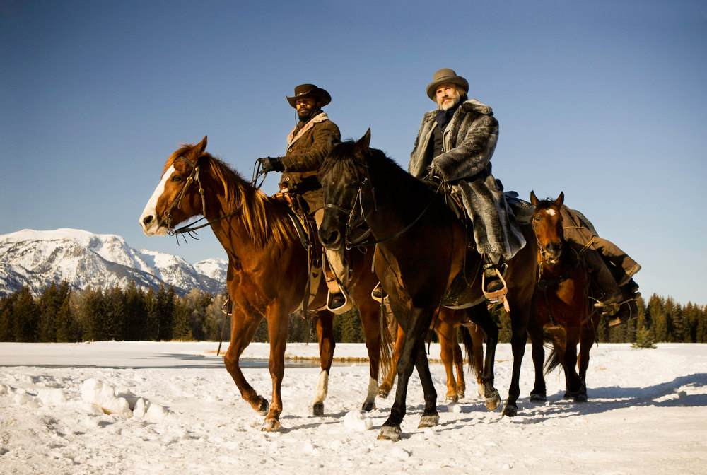Description of . This undated publicity image released by The Weinstein Company shows, from left, Jamie Foxx as Django and Christoph Waltz as Schultz in the film,