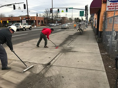 Division bike lane winter gravel cleanup