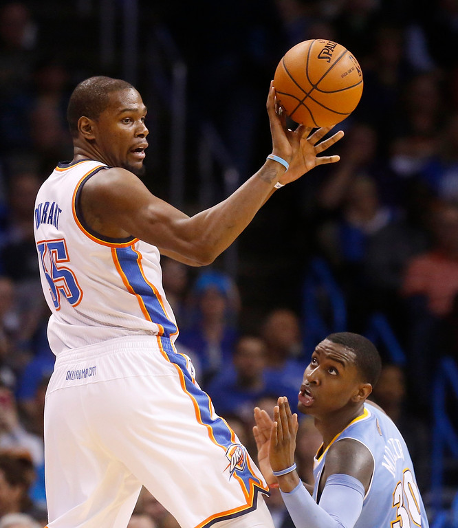 . Oklahoma City Thunder forward Kevin Durant (35) passes in front of Denver Nuggets forward Quincy Miller (30) in the second quarter of an NBA basketball game in Oklahoma City, Monday, March 24, 2014. (AP Photo/Sue Ogrocki)