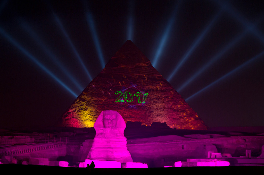 . Lights illuminate the historical site of Giza Pyramids and Sphinx to celebrate the New Year in Egypt, Sunday, Jan. 1, 2017. (AP Photo/Amr Nabil)