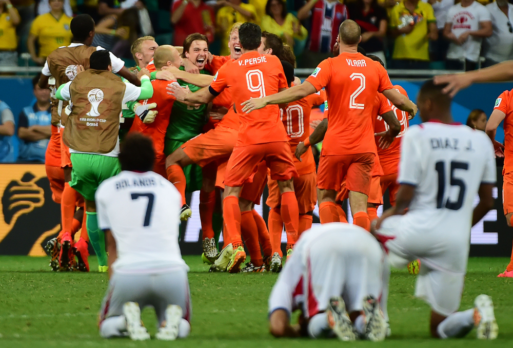. Netherlands players celebrate after the quarter-final football match between the Netherlands and Costa Rica at the Fonte Nova Arena in Salvador during the 2014 FIFA World Cup on July 5, 2014. (RONALDO SCHEMIDT/AFP/Getty Images)