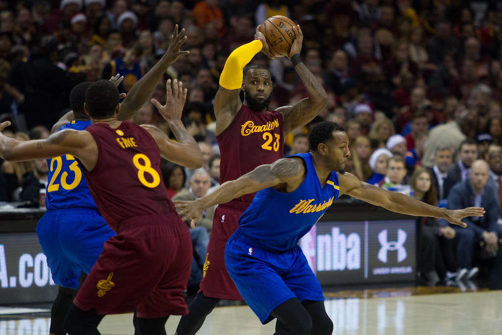 . LeBron James (23) of the Cleveland Cavaliers looks to throw a pass to Channing Frye (8) during an NBA game at the Quicken Loans Arena on Christmas day.  The Cavs defeated the Warriors 109-108.  Michael Johnson - The News Herald