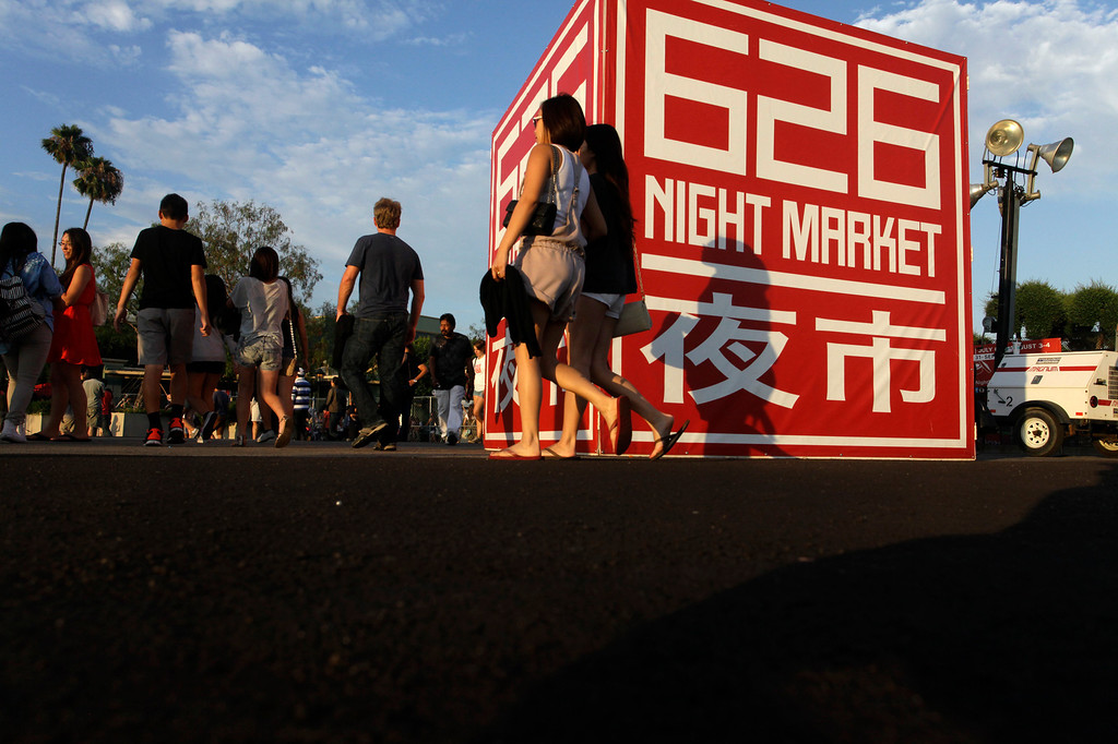 . Visitors arrive for the 626 night market at Santa Anita Park in Arcadia, Saturday August 3, 2013. (SGVN/Correspondent Photo by Ron Fu/SVCITY)