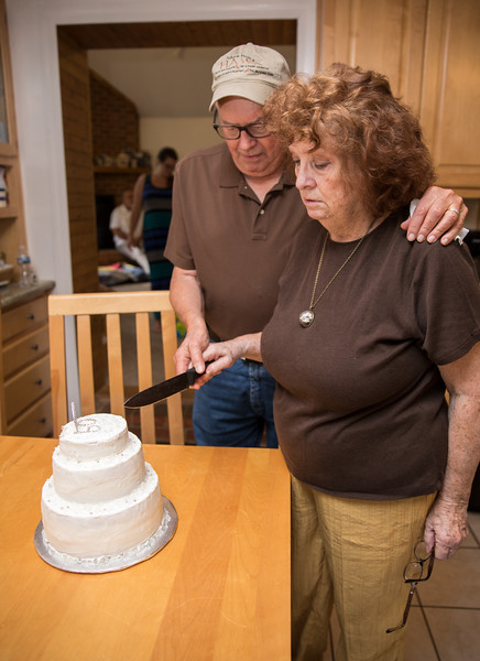Mam and Badge Cutting Cake.jpg