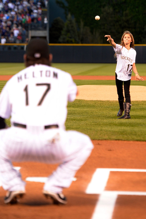 . Todd Helton receives the first pitch from his daughter Tierney Faith before the start of action in Denver. The Colorado Rockies hosted the Boston Red Sox and said farewell to longtime first baseman Todd Helton, who recently announced his retirement following this season. (Photo by John Leyba/The Denver Post)
