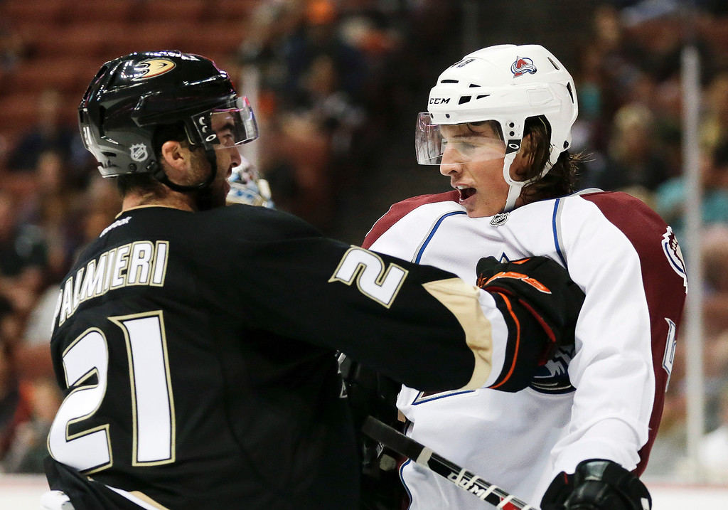 . Anaheim Ducks right wing Kyle Palmieri, left, pushes Colorado Avalanche\'s Michell Heard during the second period of an NHL preseason hockey game in Anaheim, Calif., Sunday, Sept. 22, 2013. (AP Photo/Chris Carlson)