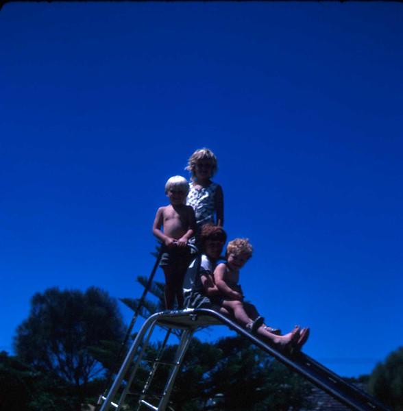 1973-1 (11) Susan 7 yrs 6 mths, Andrew 4 yrs 5 mths, David 9 yrs 1 mth & Allen 20 mths on slide @ Portsea.jpg