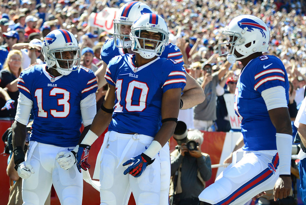 . Buffalo Bills wide receiver Robert Woods (10) celebrates with teammates EJ Manuel (3) and Steve Johnson (13) after catching a pass from Manuel for a touchdown during the first half of an NFL football game against the New England Patriots, Sunday, Sept. 8, 2013, in Orchard Park. (AP Photo/Gary Wiepert)