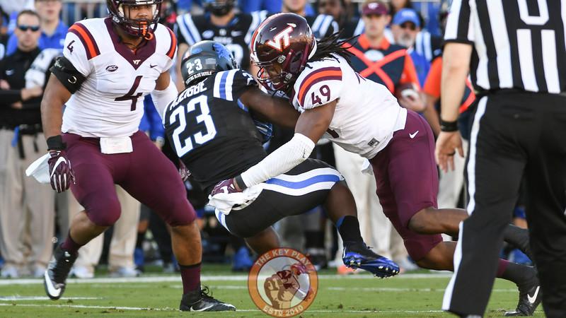Virginia Tech linebacker Tremaine Edmunds (49) lays a big hit on Duke running back Joseph Ajeigbe (23). (Michael Shroyer/TheKeyPlay.com)