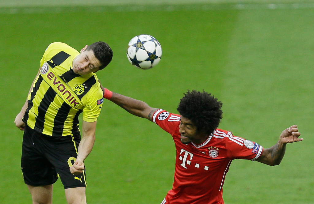 . Dortmund\'s Robert Lewandowski of Poland, left, and Bayern\'s Dante of Brazil go for a header during the Champions League Final soccer match between  Borussia Dortmund and Bayern Munich at Wembley Stadium in London, Saturday May 25, 2013. (AP Photo/Alastair Grant)
