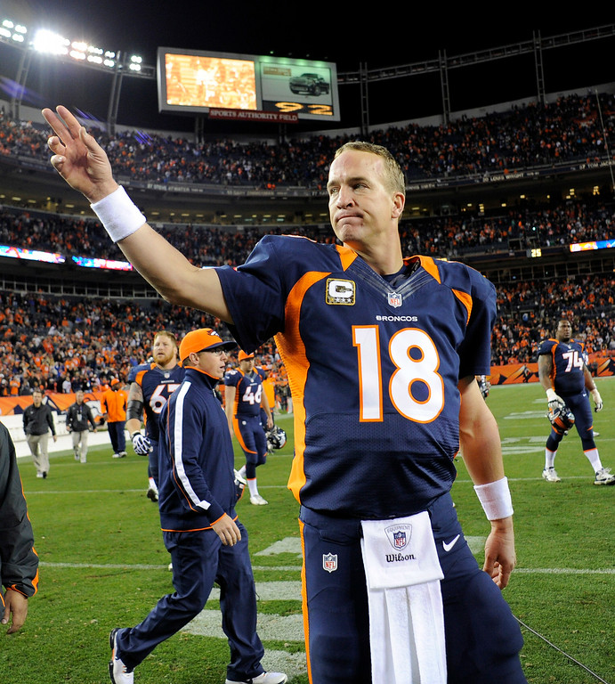 . Peyton Manning waves to the crowd after the Broncos\' 30-23 win against the Chargers. (John Leyba, The Denver Post)