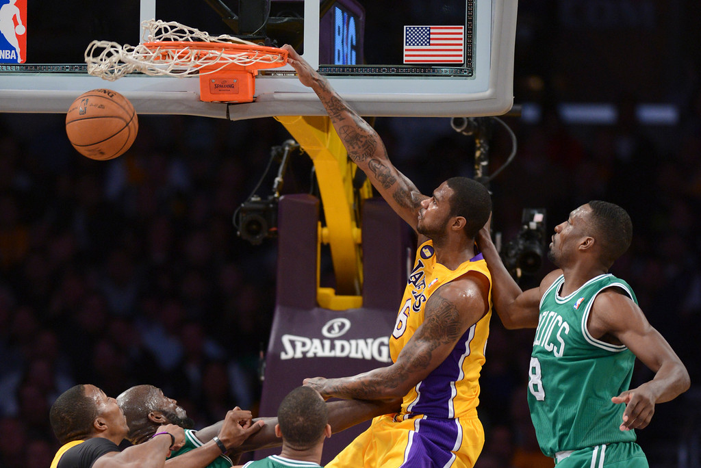 . Lakers Earl Clark slams in two as Celtics\' Jeff Green defends during first half action at Staples Wednesday.  Photo by David Crane/Staff Photographer