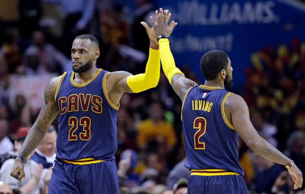 . Cleveland Cavaliers\' LeBron James (23) and Kyrie Irving (2) celebrate during an NBA basketball game against the Miami Heat Thursday, April 2, 2015, in Cleveland. (AP Photo/Tony Dejak)