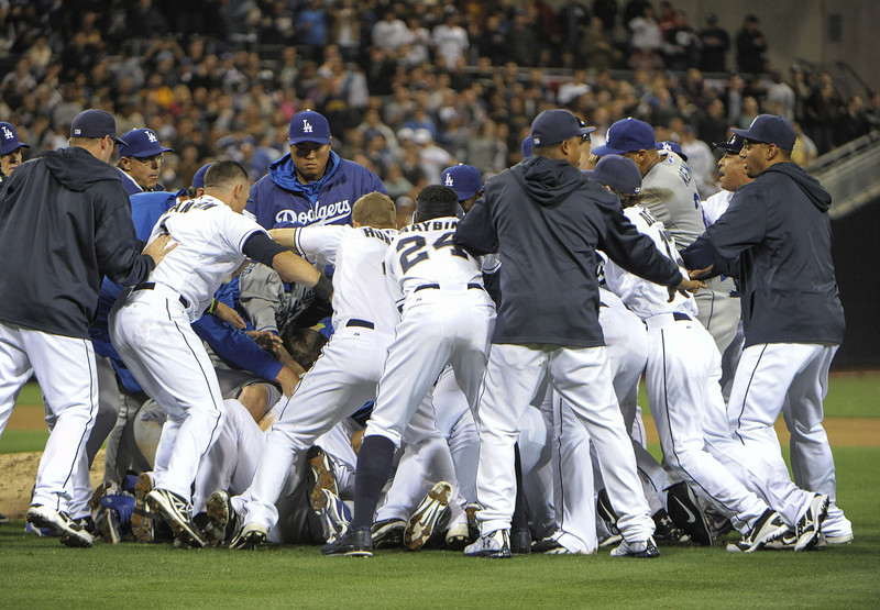 . San Diego Padres players and Los Angeles Dodgers players brawl after Carlos Quentin #18 charged Zack Greinke #21 of the Los Angeles Dodgers after being hit with a pitch during the sixth inning at Petco Park on April 11, 2013 in San Diego, California. (Photo by Denis Poroy/Getty Images)
