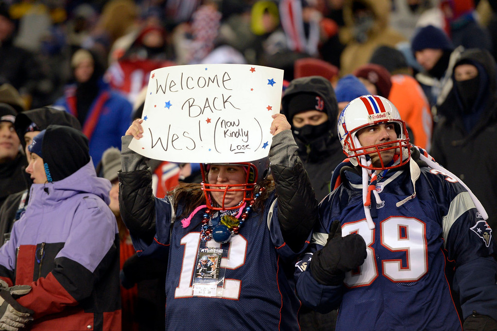 . New England Patriots fans welcome back Denver Broncos wide receiver Wes Welker during the first quarter against the New England Patriots November 24, 2013 at Gillette Stadium. (Photo by Joe Amon/The Denver Post)