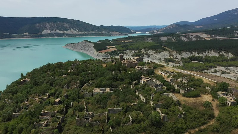 Available in 4k - Aerial photo showing abandoned village of Tiermas with church ruins at the Embalse de Yesa (Yesa Reservoir) in the Navarra Aragon region of the Spanish Pyrenees