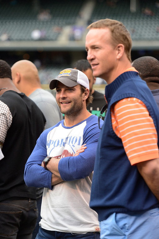 . Denver Broncos Wes Welker (L) and Peyton Manning look on during batting practice with the Colorado Rockies and New York Yankees May 7, 2013 at Coors Field. (Photo By John Leyba/The Denver Post)