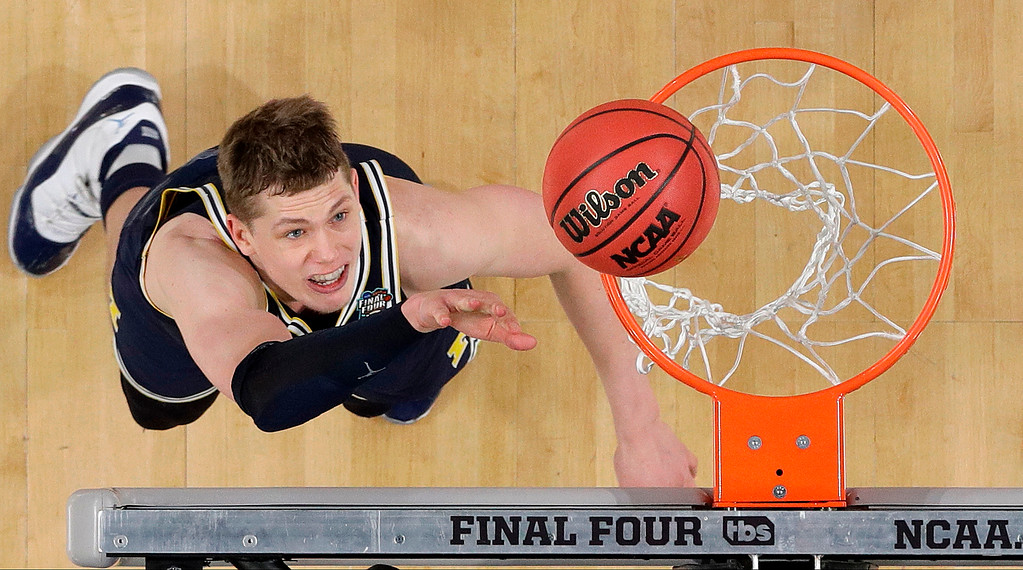 . Michigan\'s Moritz Wagner (13) watches his shot during the second half in the championship game of the Final Four NCAA college basketball tournament against Villanova, Monday, April 2, 2018, in San Antonio. (AP Photo/David J. Phillip)