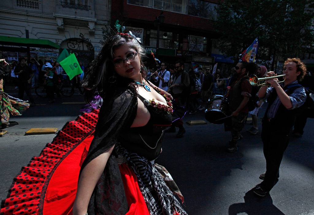 . A performer in costume dances during a march against the commemoration of the discovery of America by Christopher Columbus in Santiago, Chile, Saturday, Oct. 12, 2013. The march was organized by members of indigenous groups demanding autonomy and the recovery of ancestral land. Protesters also demonstrated against Chile\'s anti-terrorism law, under which many Mapuche Indians are under arrest. Saturday is the the anniversary of Christopher Columbus\' 1492 arrival in the Americas. (AP Photo/Luis Hidalgo)