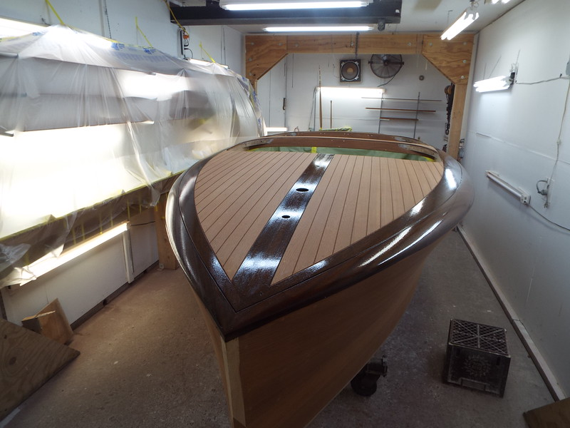After ebony stain and two coats of sealer were applied the boat is unmask so the ebony can be mask and the other stain color applied.