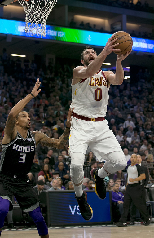 . Cleveland Cavaliers forward Kevin Love, right, goes to the basket against Sacramento Kings guard George Hill during the first quarter of an NBA basketball game, Wednesday, Dec. 27, 2017, in Sacramento, Calif. (AP Photo/Rich Pedroncelli)