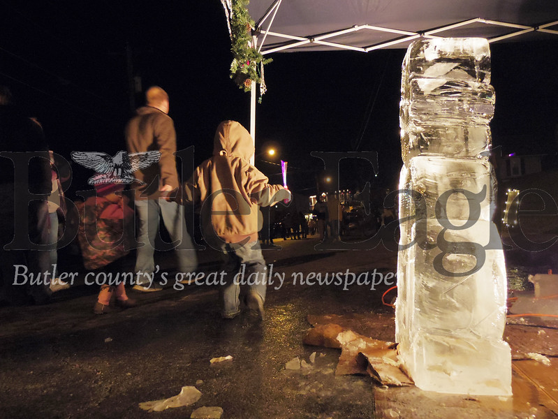 A child plays in front of an ice sculpture during Chicora's Light Up Night on Sunday. Phot by Eric Jankiewicz