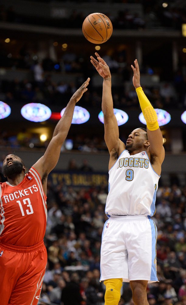 . DENVER, CO. - JANUARY 30: Denver Nuggets shooting guard Andre Iguodala (9) takes a shot over Houston Rockets shooting guard James Harden (13) during the first quarter January 30, 2013 at Pepsi Center. The Denver Nuggets take on the Houston Rockets in NBA action. (Photo By John Leyba/The Denver Post)