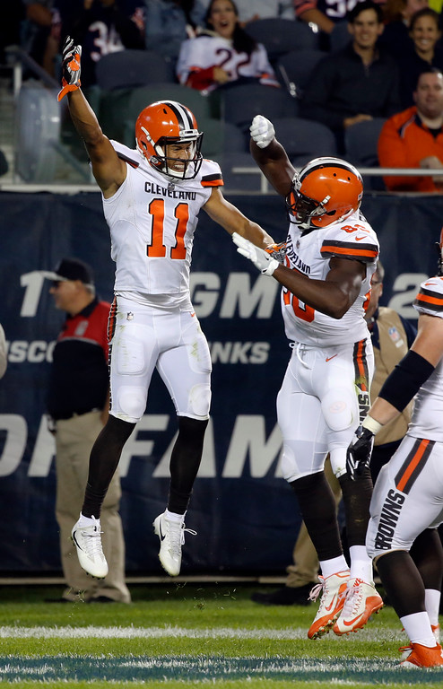 . Cleveland Browns wide receiver Jordan Leslie (11) celebrates a touchdown with tight end Randall Telfer (86) during the second half of an NFL preseason football game against the Chicago Bears, Thursday, Aug. 31, 2017, in Chicago. (AP Photo/Charles Rex Arbogast)