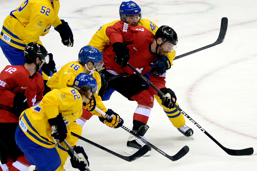 . Sweden\'s Jimmie Ericsson holds Switzerland\'s Julien Vauclair during the action at Bolshoy Arena. Sochi 2014 Winter Olympics on Friday, February 14, 2014. (Photo by AAron Ontiveroz/The Denver Post)