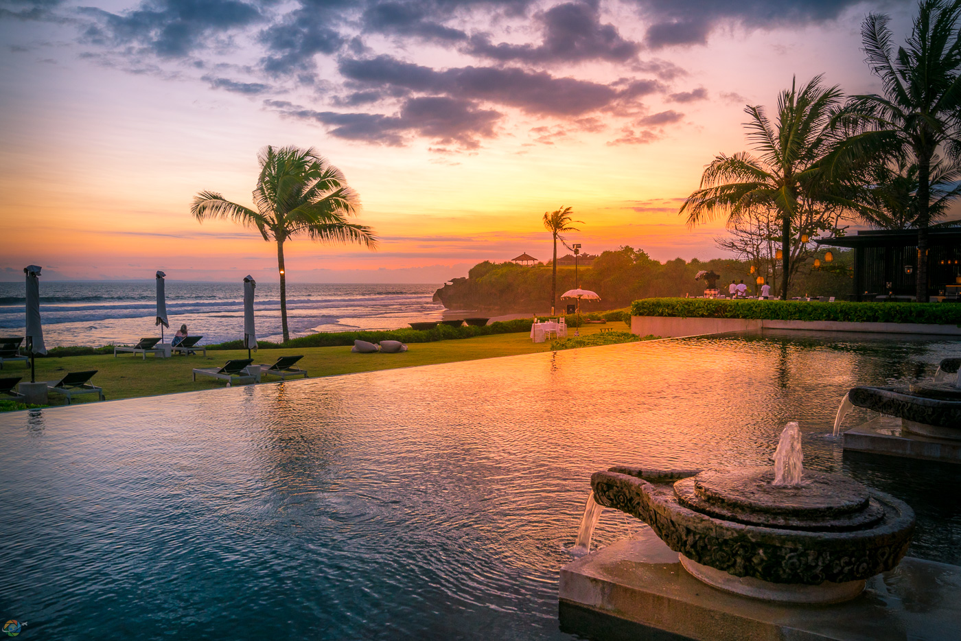The setting sun adds color to the beautiful SOORI Bali pool.