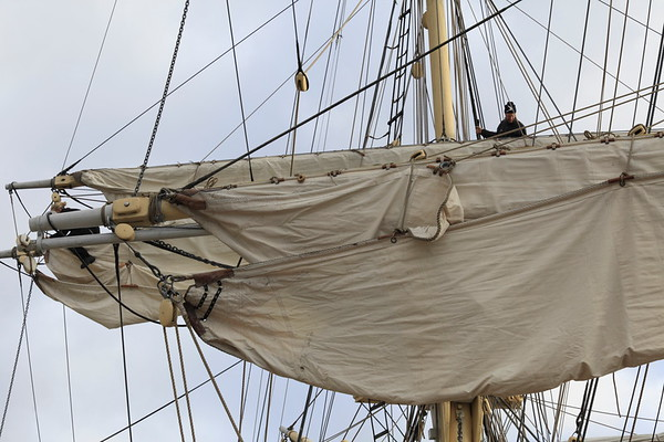 Mariner in the rigging of a brig