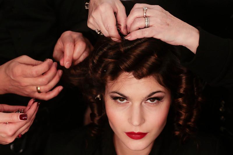 . Model Lina Sandberg gets her hair prepared prior to the presentation of Lena Hoschek\'s Autumn Winter 2014 collection during the Mercedes Benz Fashion Week in Berlin, Tuesday, Jan. 14, 2014. (AP Photo/Markus Schreiber)