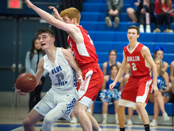12/27/19 Wesley Bunnell | StaffrrBerlin boys basketball defeated Plainville on Friday night at Plainville High School. Plainville's AJ Lestini (11)against Berlin's Ben Lincoln (30).