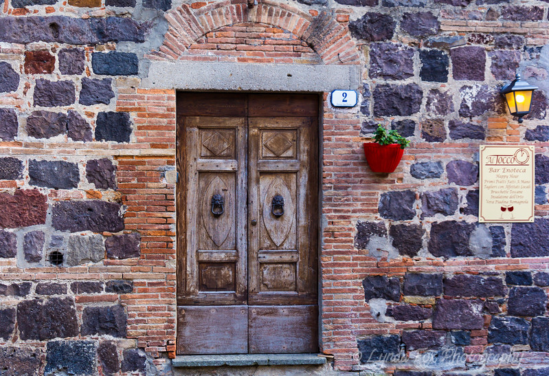 Old Stone Wall with Wooden Door