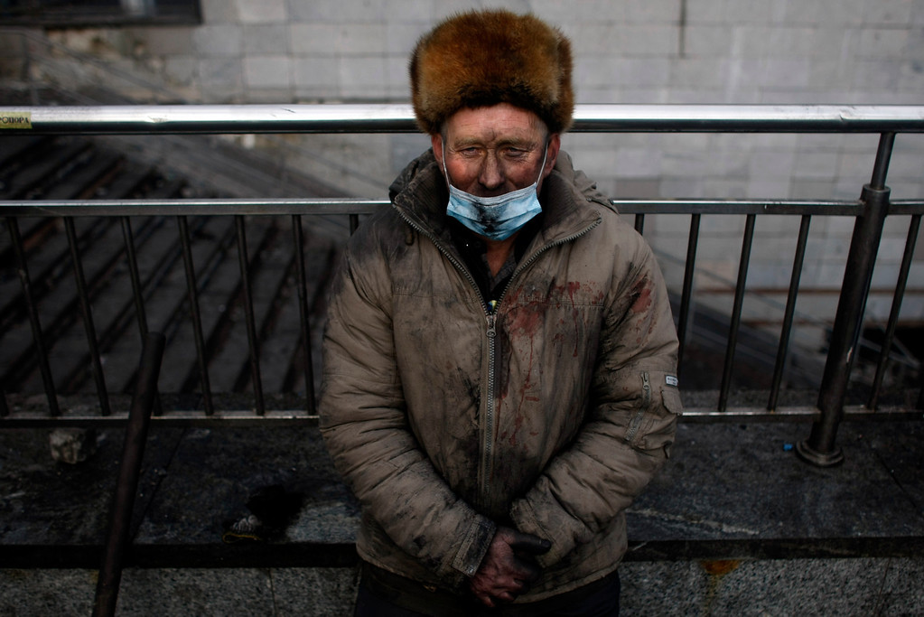 . An anti-government protester takes a break at  Independence Square in Kiev, Ukraine, Thursday, Feb. 20, 2014. (AP Photo/ Marko Drobnjakovic)