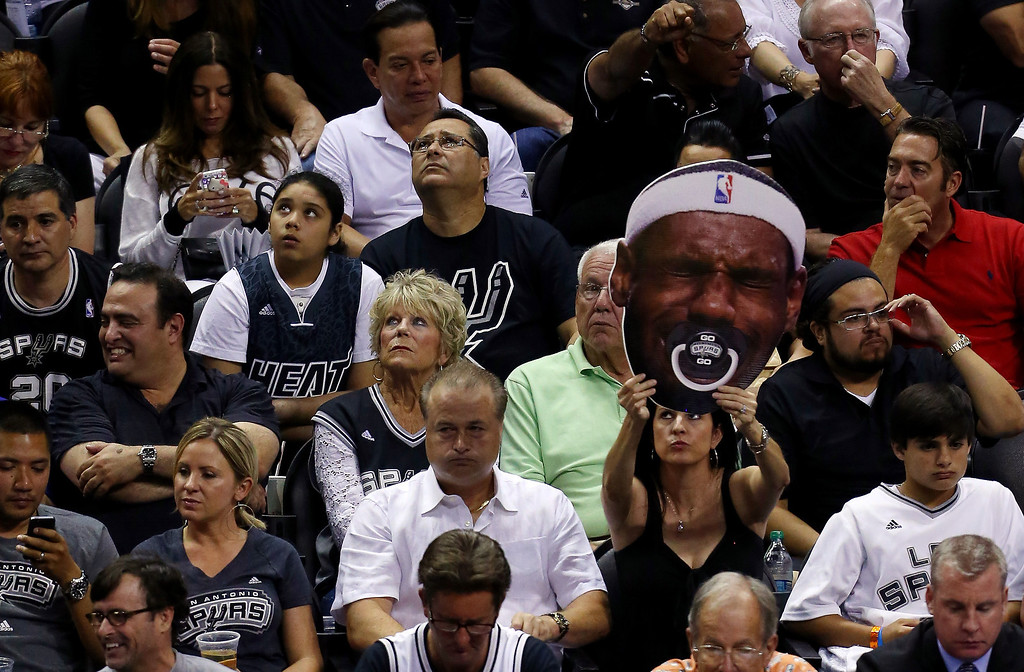 . A San Antonio Spurs fan holds up a sign against the Miami Heat during Game Two of the 2014 NBA Finals at the AT&T Center on June 8, 2014 in San Antonio, Texas.  (Photo by Chris Covatta/Getty Images)