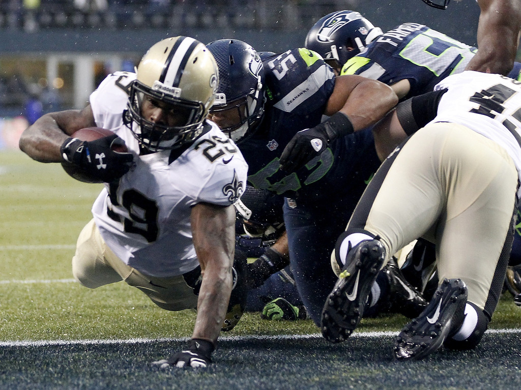. SEATTLE, WA - JANUARY 11:  Running back Khiry Robinson #29 of the New Orleans Saints dives into the endzone for a one-yard touchdown in the fourth quarter against the Seattle Seahawks during the NFC Divisional Playoff Game at CenturyLink Field on January 11, 2014 in Seattle, Washington.  (Photo by Otto Greule Jr/Getty Images)