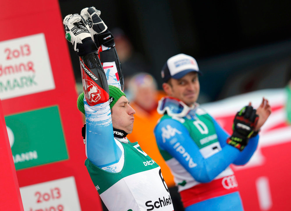 Description of . Second placed Marcel Hirscher (L) of Austria and third placed Manfred Moelgg of Italy celebrate after the men's Giant Slalom race at the World Alpine Skiing Championships in Schladming February 15, 2013.     REUTERS/Leonhard Foeger