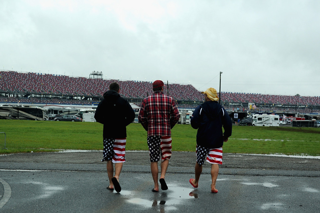 . TALLADEGA, AL - MAY 04:  Race fans walk through the infield during qualifying for the NASCAR Sprint Cup Series Aaron\'s 499 at Talladega Superspeedway on May 4, 2013 in Talladega, Alabama. Qualifying was canceled due to inclimate weather. (Photo by Patrick Smith/Getty Images)