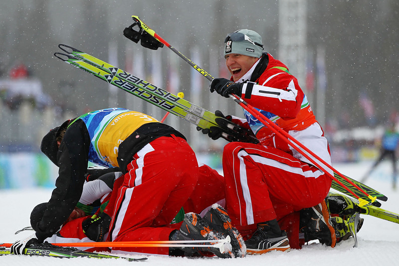 . Mario Stecher of Team Austria gets swarmed by his teammates as they celebrate winning the Olympic Gold ini the nordic combined on day twelve of the 2010 Vancouver Winter Olympics at Whistler Olympic Park Ski Jumping Stadium on February 22, 2010 in Whistler, Canada.  (Photo by Lars Baron/Bongarts/Getty Images)