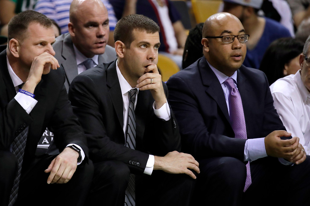 . Boston Celtics head coach Brad Stevens, center, watches with assistants Jay Larranaga, left, and Micah Shrewsberry during the second half of Game 2 of the NBA basketball Eastern Conference finals against the Cleveland Cavaliers, Friday, May 19, 2017, in Boston. (AP Photo/Elise Amendola)
