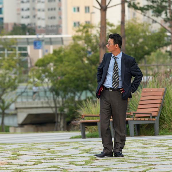 Businessman standing in park, Seoul, South Korea