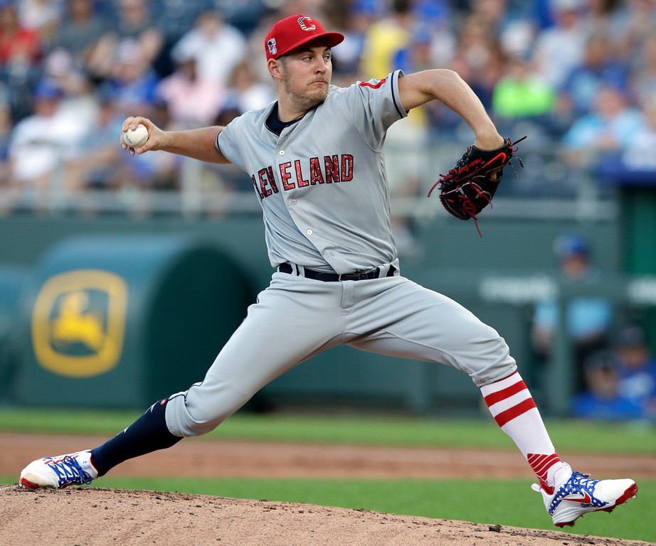 . Cleveland Indians starting pitcher Trevor Bauer delivers to a Kansas City Royals batter during the first inning of a baseball game at Kauffman Stadium in Kansas City, Mo., Wednesday, July 4, 2018. (AP Photo/Orlin Wagner)