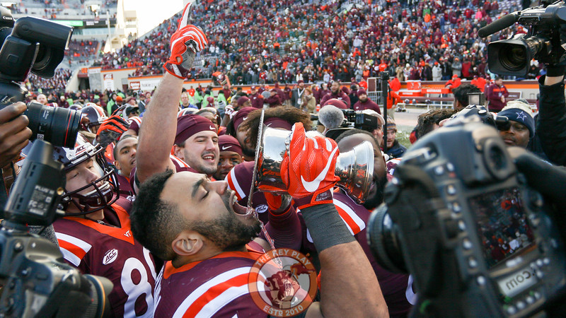 Ken Ekanem takes a drink out of the Commonwealth Cup Trophy after the Hokies' victory. (Mark Umansky/TheKeyPlay.com)