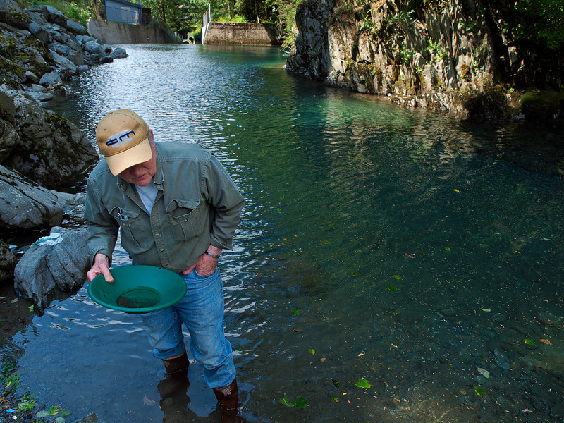 Pat checks Gold Creek for gold.... finding only some dust bits.