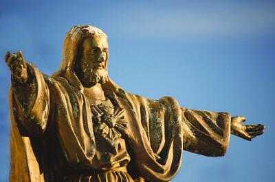 //www.dreamstime.com/stock-images-old-worn-statue-jesus-christ-against-blue-sky-image31675784
