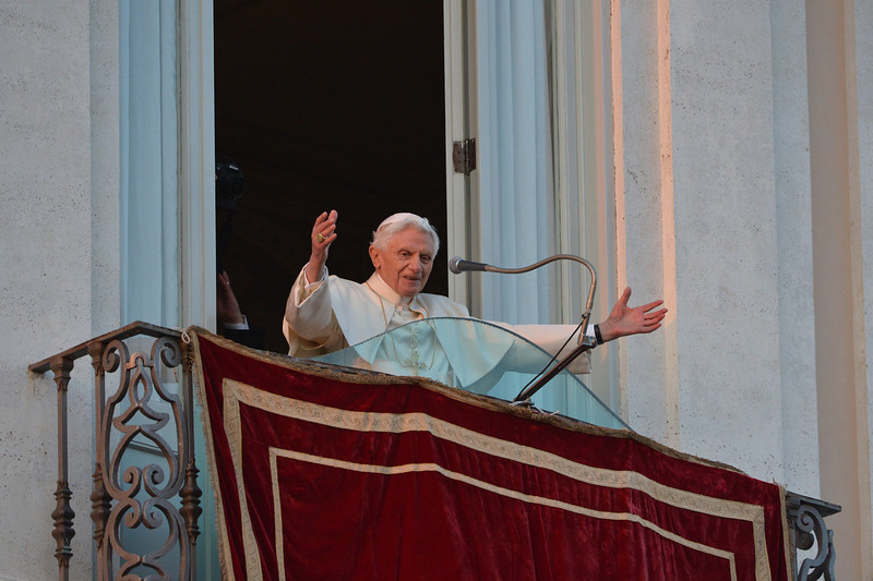 . Pope Benedict XVI waves to faithful from a balcony upon arrival in Castel Gandolfo on February 28, 2013. Once he steps down later in the day, Pope Benedict XVI will begin his retirement in the papal summer residence at Castel Gandolfo, a sumptuous villa outside Rome with ornamental gardens, breathtaking views and its own farm.  VINCENZO PINTO/AFP/Getty Images