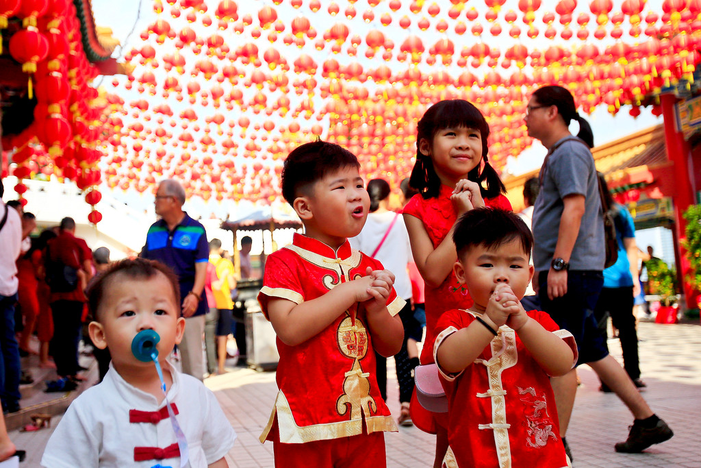 . Malaysian ethnic Chinese children pose for pictures on the first day of Chinese Lunar New Year at a temple in Kuala Lumpur, Malaysia, Friday, Feb. 16, 2018. The celebration marks the Year of the Dog in the Chinese calendar. (AP Photo/Sadiq Asyraf)